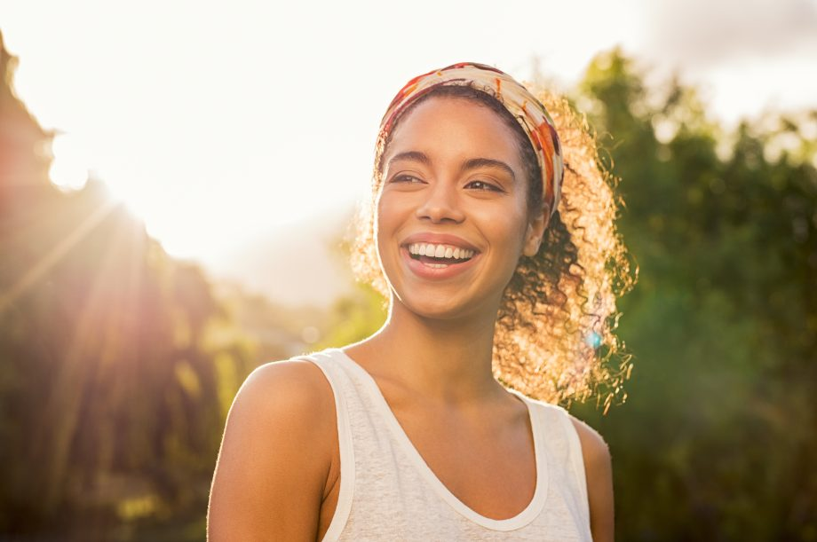 Young Woman Smiling in the Sunshine